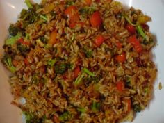 Nasi Goreng in Brown Rice A yummy, easy dinner recipe. Nasi Goreng, Potluck Recipes, Easy Dinner Recipes, Asian Recipes, Healthy Recipes, Ethnic Recipes, Healthy Food, Yummy Food, Tasty