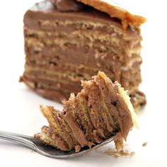 Dobos torte is a well-known Hungarian dessert. It is a five-layer sponge cake, layered with chocolate buttercream and topped with thin caramel slices. The sides of the cake are sometimes coated with ground hazelnuts, chestnuts, walnuts or almonds but the original cake is uncoated, since it was a slice of a big cake.