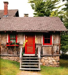 I love the red trim and doors.  This reminds me of Love's Ranch near Chalk Creek in Colorado.....