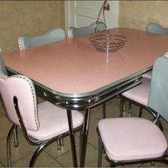 The perfect pink laminex table. Red transferwear would look so groovy on this table! Kk