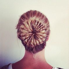 cool bun.. as per Tabitha: Sadly there isn't a link for how to do it, but I would think you could do it by putting your hair in a ponytail and putting a doughnut (or sock with the toe cut off and rolled up) on. Then taking small bits and twisting them, loop them over the doughnut and pin down.