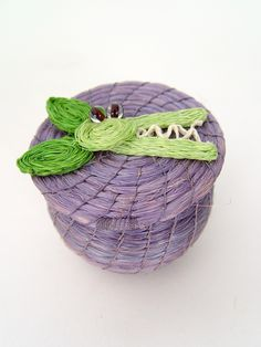 "Crocodile Lidded Basket $11.00. This adorable African novelty basket was hand woven out of sisal by a collective of female master weavers in Swaziland.    Height: 2""  Width: 2.5""  Artist: Tintsaba  Made in: Swaziland"