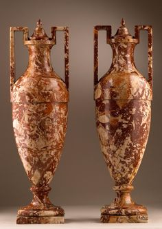 ROME, late 18th century. A pair of Breccia marble amphora vases and covers