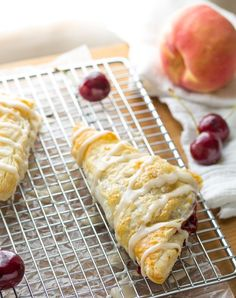 Cherry & Peach Turnovers with a Sweet Bourbon Glaze. Ready in under 40 minutes! | sweetpeasandsaffron.com