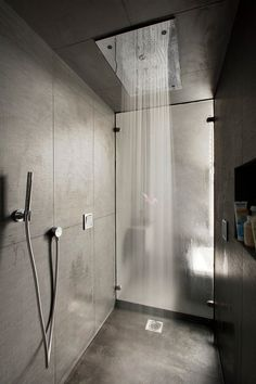 Walk in Hansgrohe rain shower in a contemporary Victorian terrace home in London by NS Interiors