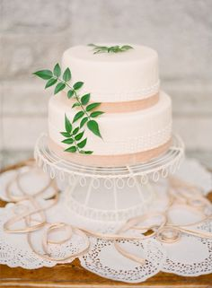 Simple wedding cake with greenery.   Photo by KT Merry Photography. www.wedsociety.com  #wedding #cake