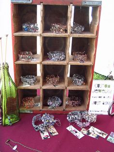 bottle case bracelet display, I painted the backgrounds of the cubes so the bracelets showed off better.