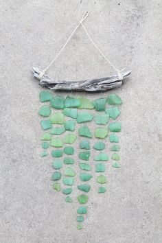 Beach wood & sea glass wind-chime idea.