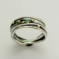 stone ring - Sterling silver wrapped band mixed gold with blue opal gemstone - It feels right.