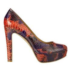 """Straight from the Runway! Whitney Port featured this shoe at New York Fashion Week.....round toe pump with 5"""" heel and 1 1/4"""" platform. Due to the nature of platform pumps, the high pitch may cause your foot to slide forward. We are including a pair of insoles with your purchase to adjust the fit to your foot, if needed."""