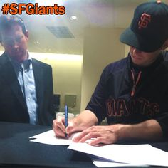 """Buster's going to be a #SFGiant for a LONG time!  Dotting the """"i's"""" and crossing the """"t's"""" on his contract!"""