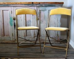 Absolutely beautiful pair of Hollywood Regency gold, velvet metal folding chairs.  These chairs are not only pretty, but they are so