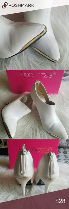 Shoedazzle white zip up booties Good condition. Sole in like new condition.  Only worn a handful of times.  White with gold tips. Super show stopper booties. Shoe Dazzle Shoes Ankle Boots & Booties