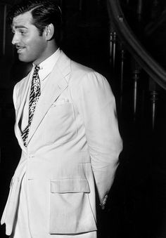 Clark Gable's linen suit or sport coat he wears at the start of China Seas.  It is similar to his great tweed sportcoat in It Happened One Night that we all love.  Linen or Palm Beach belted action back (shoulder pleats), flapped box pockets and double breast pockets (the tweed one had a single breast box pocket).""