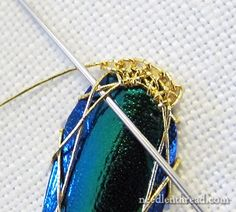 If you've never heard of beetle wings being used with embroidery, you'll find some magnificent images online. I've worked a beetle wing and goldwork project and written a few articles on beetle wing embroidery here on Needle 'n Thread, including tips on preparing beetle wings for embroidery.