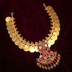 Traditional coin necklace with peacock pendant studded with rubies, emeralds and polki stones. Gold balls are attached at the end for embellishment. 18k Gold Jewelry, Golden Jewelry, Gold Jewellery Design, Pendant Jewelry, Jewelery, Ruby Pendant, Indian Jewelry Sets, Bridal Jewelry Sets, Bridal Jewellery