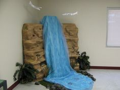 Waterfall Blue Plastic Tableclothes White Fabric Blue Cellophane White Lights And Rocks On