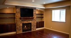 I wonder if I could do some sort of fireplace in old TV built in. Basement Flooring, Basement Remodeling, Basement Ideas, Flooring Tiles, Tv Built In, Built Ins, Finished Basement Company, Pottery Barn Style, Craftsman Style