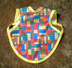 Waterproof Bapron/The Baby Apron - 6-18 months with Lego block print by GrandmaSewsBest on Etsy