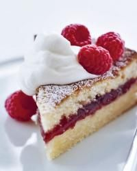 Lemony Semolina-Jam Cake | Make the cake with regular lemon juice, bake it in a single springform pan, then slice it in half and add a layer of tart raspberry preserves for a hint of color and flavor.