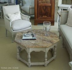 A fabulous Moroccan style octagonal coffee table with trompe l'oeil marble painted top.