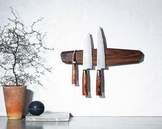 A magnetic piece of wood that puts your fanciest knives on display: | 21 Minimalist Storage Solutions That Are Basically Works Of Art