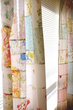 Patchwork curtains made from vintage sheets and pillowcases. Charming.