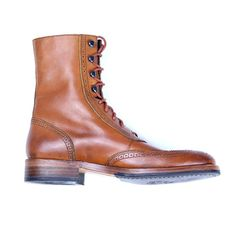 Originally a country walking shoe, brogue styling has become an undisputed classic in men's footwear. The Winchester boot's hand-rubbed leather upper features perforated details with a subtle contrast underlay. The short wing-tip design lends a sleek look on the foot, while leather sheepskin lining and a full leather-over-foam insole provides comfort and cushioning. Crafted with classic Goodyear® Welt construction, the Winchester boot is the perfect match for the modern gentleman.