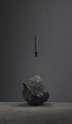 Meta - A timeless pendant lamp made from volcanic rock and coated aluminium by studio Dark toned nuances enclose the warm light cone that strikes the surface below. An enigmatic statement brought to its minimum. David Pompa, Home Interior Design, Interior And Exterior, Modern Interior, Sculpture Art, Sculptures, Lamp Cord, Sombre, Contemporary Sculpture