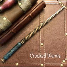 """Length - 12 1/2"""" Wood - Pin Cherry Crookedness - Slightly Crooked This listing is for a very nice wand carved from a branch pruned from my Pin Cherry tree. This handsome wand features a lovely blue and black handle and lovely twisted shaft. I used an ebonizing technique to darken the"""