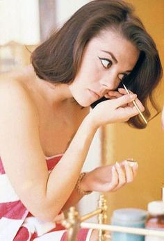 Natalie Wood putting on her makeup