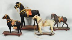 "Sold For $ 450   Four children's wheeled horse pull toys, 19th C., Largest: 18 1/2"" high, 17 1/2"" long; smallest: 11"" high, 12 1/4"" long. Condition: soiling, damage, losses, as is."