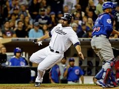 Game #112 8/6/12: San Diego Padres' Carlos Quentin scores past Chicago Cubs catcher Welington Castillo during the fourth inning of a baseball game, Monday, Aug. 6, 2012, in San Diego. (AP Photo/Lenny Ignelzi)