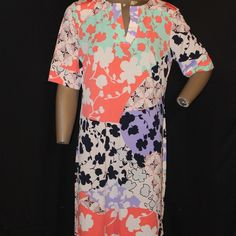 Printed dress This dress is about 7in long, and very pretty. This is beautiful print, with a V cut neck. This dress is lightweight and good for a nice day in the beach. Dress Barn Dresses