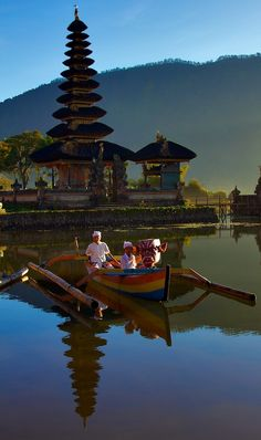 Ulun Danu temple at the Bratan lake - Bali, Indonesia Bali is an island of temples everywhere - small intimate ones, and large magnificent one, and everything in betwen. Unlike the rest of Indonesia (Muslim), Bali is Hindu. Places Around The World, Oh The Places You'll Go, Travel Around The World, Places To Travel, Around The Worlds, Bali Lombok, Laos, Denpasar, Ubud