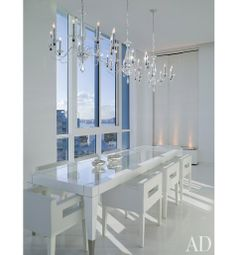 Post installed elegant yet understated chandeliers by Schonbek over the J. Robert Scott dining table.