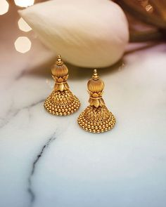 Explore exquisite temple jewellery inspired by temple art and architecture. This sublime collection of gold jewellery from Tanishq is an embodiment of grace and magnificence. Gold Jhumka Earrings, Gold Earrings Designs, Gold Jewellery Design, Antique Earrings, India Jewelry, Ear Jewelry, Bridal Jewelry, Diamond Jewelry, Gold Jewelry