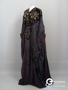 Stage costume Purple silk coat decorated with black velvet and applied old gold embroidery motifs. Red silk lining. Costume for a theatrical play.