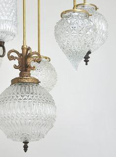 Hand-blown glass fixtures in varying shades of green at the ...