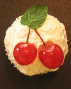 Holly Cupcakes: Your Martha-Inspired Cupcakes  These seasonal cupcakes use cherries and real leaves to form their holly. We used a trio of sour-cherry candies and a pair of sugar-frosted spearmint leaves for our Holly Cupcakes.