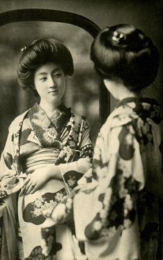Geisha Sakae looking in a Mirror 1910s