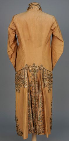 Rear view, coat, France, 1760-1780. Tan silk having woven pinstripe, decorated with metallic embroidery, sequins, colored paillettes and paste jewels, embroidered buttons throughout, silk lining.