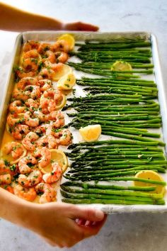 ONE PAN Roasted Lemon Garlic Butter Shrimp and Asparagus tossed with chili flakes and fresh parsley is not only bursting with flavor but on your table in 15 MINUTES!  No joke!  This recipe is the easiest, most satisfying meal that tastes totally gourmet.  Stock up on frozen shrimp and you can make this luxurious tasting meal at moment's notice.  Serve the (customizable heat) spicy lemon garlic butter shrimp plain or turn it into lemon garlic butter shrimp pasta!