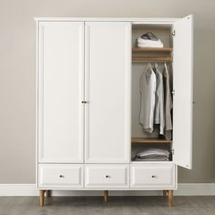 Something like this in the back bedroom? Ercol Devon Wardrobe | The White Company