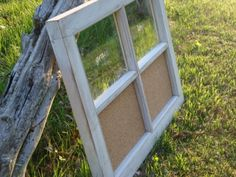 I like this cork board idea using an old window frame.  Humm....I have a couple of these old window frames in the garage that I've been wondering what to do with...
