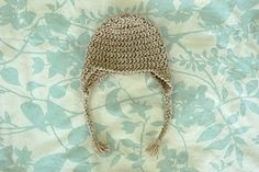 Free crocheted infant hat pattern. I used this for a niece hat and a nephew hat.  Earflaps are irresistible!