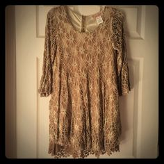 Lacey boutique brown dress This is a beautiful tan/brown dress. It's silky smooth on the inside and loose fitting so comfortable to wear! I've only wore it a couple of times bc I don't dress up much.  Dresses Mini