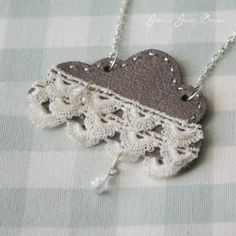 Crazy adorable with the scalloped layers of lace trim. #raincloud #necklace