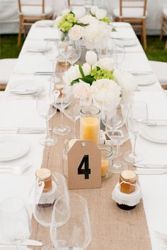White tablecloth + white plates + colored napkin for a pop of color + burlap runner + simple flowers