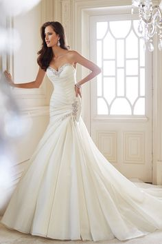 Show off your figure in this glamorous trumpet silhouette from Sophia Tolli